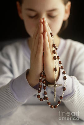 Praying With Rosary Beads Poster by Jim Corwin
