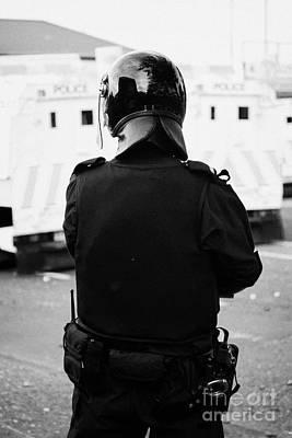Psni Officer In Riot Gear On Crumlin Road At Ardoyne Shops Belfast 12th July Poster by Joe Fox