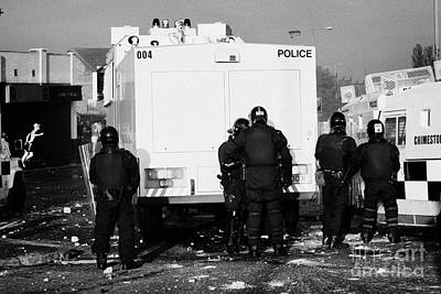 Psni Officers Behind Water Canon During Riot On Crumlin Road At Ardoyne Shops Belfast 12th July Poster by Joe Fox