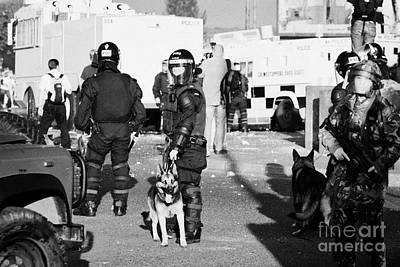 Psni Riot Officers And Dog Handler And Armed Soldiers On Crumlin Road At Ardoyne Shops Belfast 12th  Poster by Joe Fox