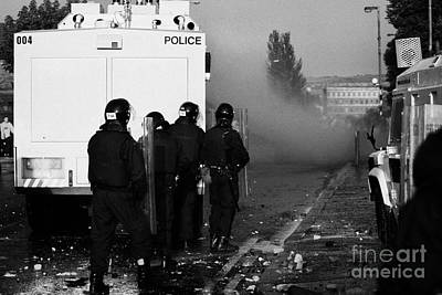 Psni Riot Officers Behind Water Canon During Rioting On Crumlin Road At Ardoyne Shops Belfast 12th J Poster