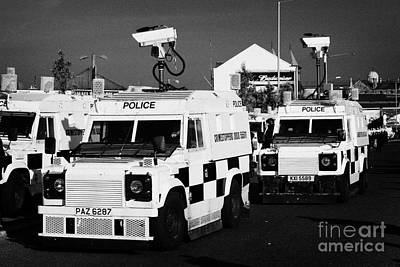 Psni Surveillance Landrovers With Cameras On Crumlin Road At Ardoyne Shops Belfast 12th July Poster by Joe Fox