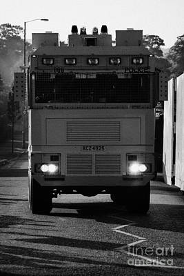 Psni Water Canon On Crumlin Road At Ardoyne Shops Belfast 12th July Poster by Joe Fox