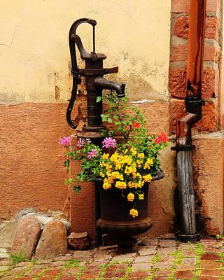Pump And Flowers In Kaysersberg France Poster