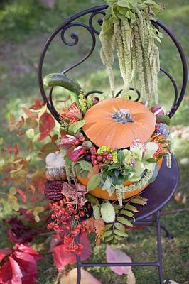 Pumpkin Decorated With Flowers On Garden Chair Poster