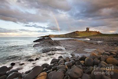 Rainbow At Dunstanburgh Castle Poster by Mark Sunderland