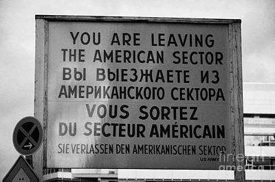 reconstruction of the you are leaving the american sector sign at checkpoint charlie Berlin Germany Poster by Joe Fox