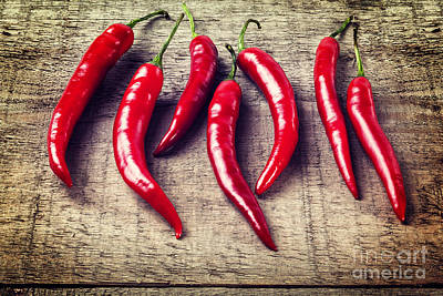 Red Chillies On Rustic Background Poster by Colin and Linda McKie
