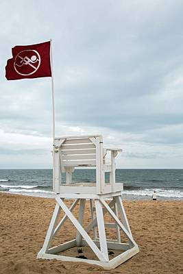 Red Flag At A Beach Poster by Jim West