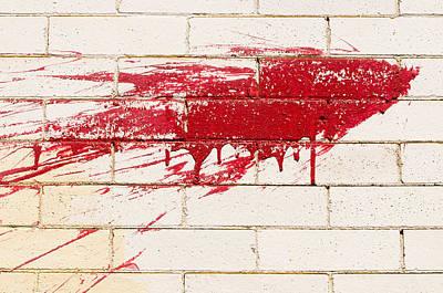 Red Splash On Brick Wall Poster