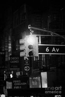 red traffic stop sign on 6th Avenue at night new york city Poster by Joe Fox