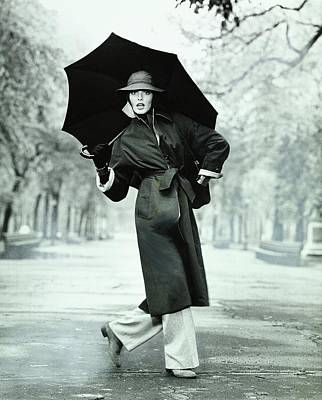 Rene Russo Wearing A Coat And Trousers Poster by Francesco Scavullo