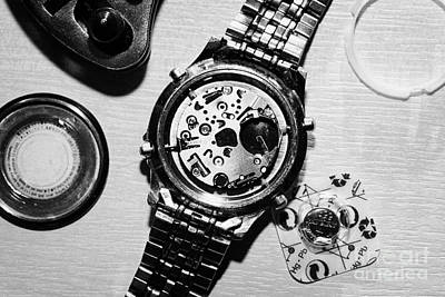 Replacing The Battery In A Metal Band Wrist Watch Poster