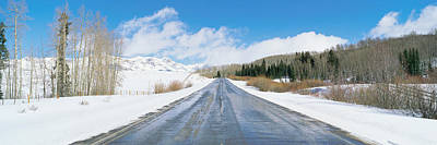 Road Through Snow Covered Countryside Poster