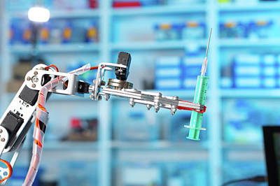 Robotic Equipment Holding Syringe In Lab Poster