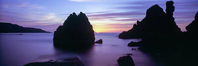 Rock Formations In The Sea At Sunset Poster