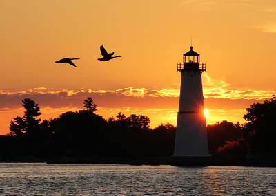 Rock Island Lighthouse Silhouettes Poster by Lori Deiter