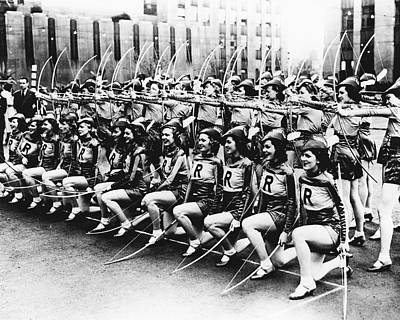 Rockettes Do Archery Too Poster by Retro Images Archive
