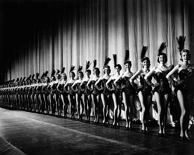 Rockettes In Tight Line In Front Of Curtain Poster by Retro Images Archive
