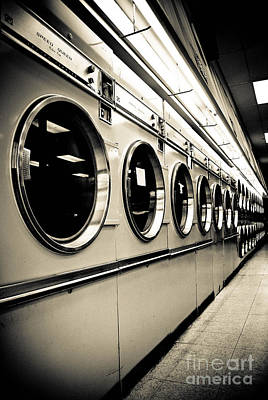 Row Of Washing Machines In Laundromat Poster by Amy Cicconi