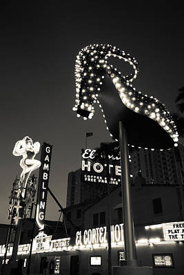 Ruby Slipper Neon Sign Lit Up At Dusk Poster by Panoramic Images