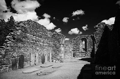 Ruins Ruined Remains And Gravestones Inside The Cathedral At Glendalough Monastic Site Poster by Joe Fox