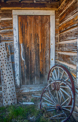 Rustic Door And Wagon Wheels Poster by Paul Freidlund