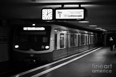 s-bahn train speeding through unter den linden underground station Berlin Germany Poster