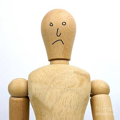 Sadness Wooden Figurine Poster