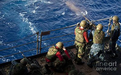 Sailors Fire M240 Machine Guns Aboard Poster by Stocktrek Images