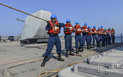 Sailors Heave A Line During A Man Poster