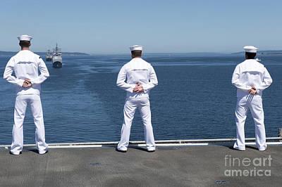 Sailors Man The Rails Aboard Uss Essex Poster by Stocktrek Images
