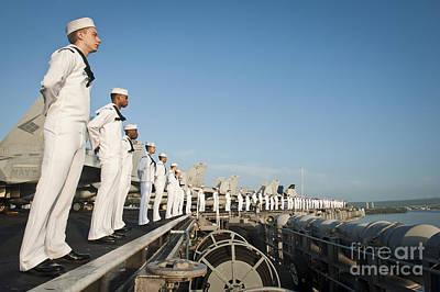 Sailors Man The Rails Of Uss Nimitz Poster by Stocktrek Images