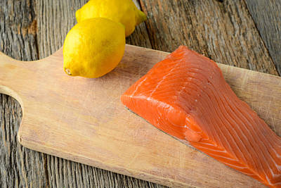 Salmon With Lemons On Wood Background Poster