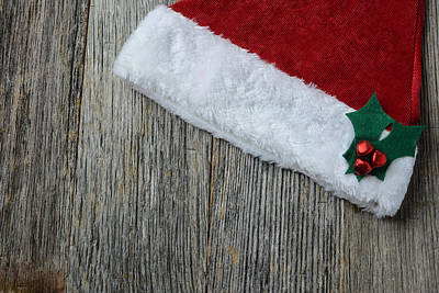 Santa Hat On Rustic Wood Background Poster by Brandon Bourdages