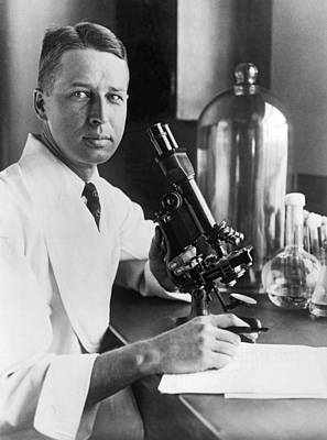 Scientist With Microscope Poster by Underwood Archives