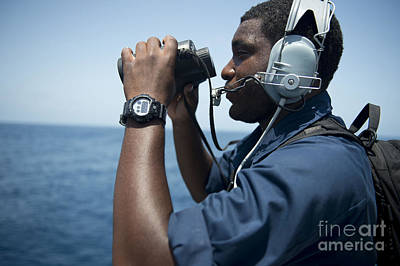 Seaman Stands Lookout Aboard Uss Poster by Stocktrek Images