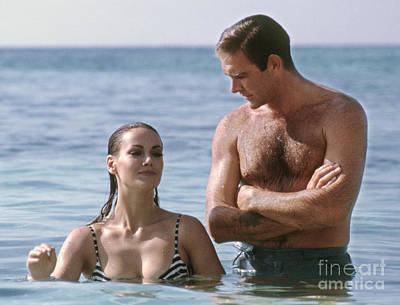 Sean Connery And Claudine Auger During Filming Of Thunderball Poster by The Harrington Collection