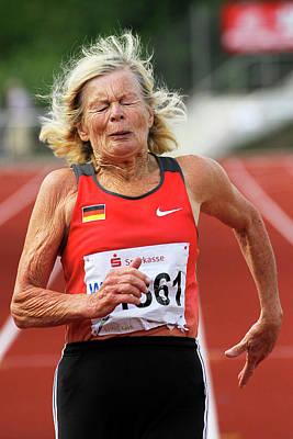 Senior Athlete Runs Through The Pain Poster