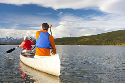 Senior Couple Canoeing In Wonder Lake Poster by Michael DeYoung