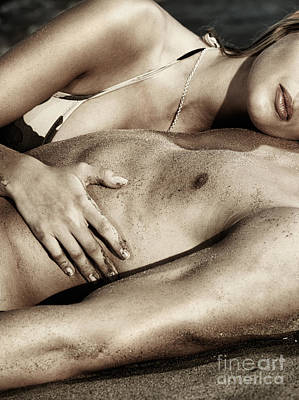 Sensual Closeup Of A Couple Lying Together On Sand Poster