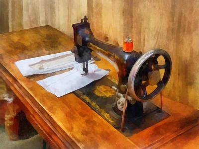 Sewing Machine With Orange Thread Poster by Susan Savad