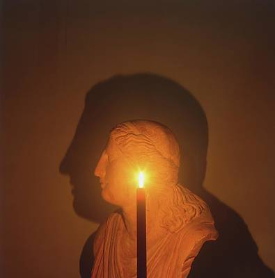 Shadow Of A Bust In Candle Light Poster by Dorling Kindersley/uig