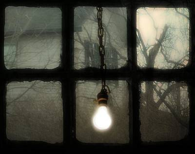 Lit Light Bulb Shines In Old Window Poster