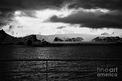 ship passing by as evening falls over livingstone island the south shetland islands Antarctica Poster by Joe Fox