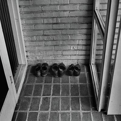 Shoes At The Entrance Of A House Poster by Andre Kertesz