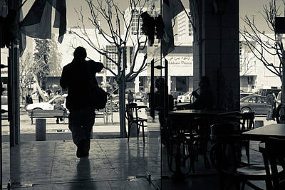 Silhouette Of A Person At Cafe Poster