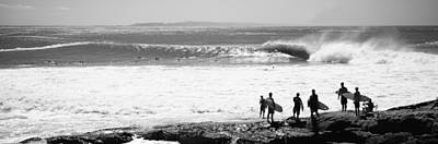 Silhouette Of Surfers Standing Poster