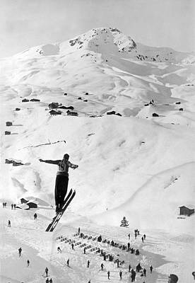 Skier Leaping Over A Valley Poster by Underwood Archives