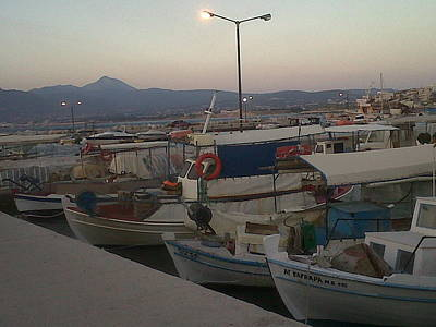 small boats at sunset in Corinthos         Poster